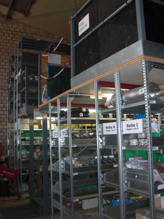 Mezzanine construction with shelving racks
