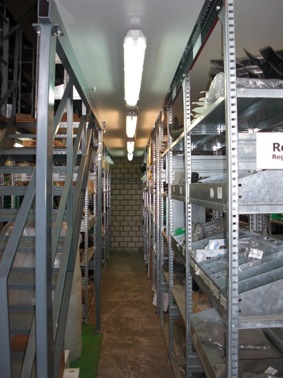 Shelving racks with mezzanine