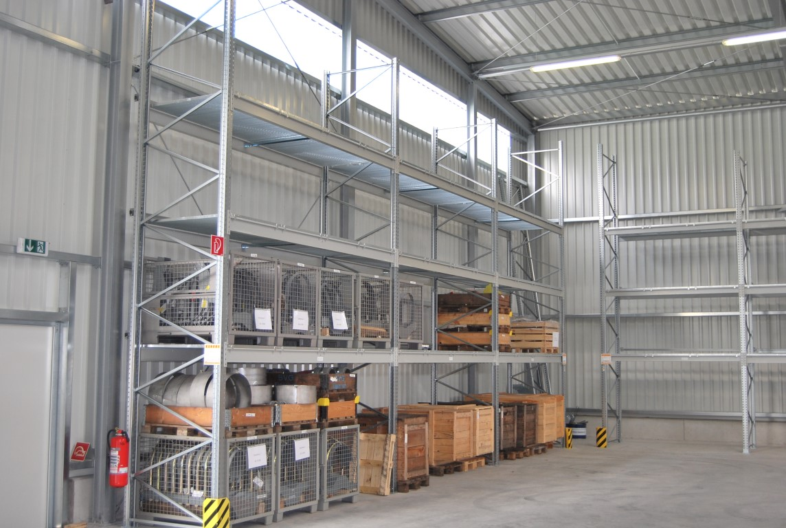 Pallet racking with grate decking indoors