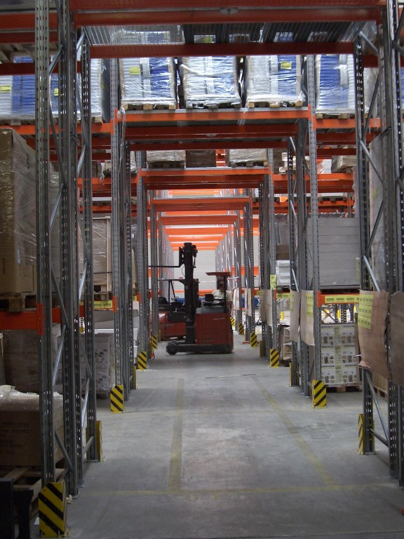 Pallet racking with forklift passageway indoors