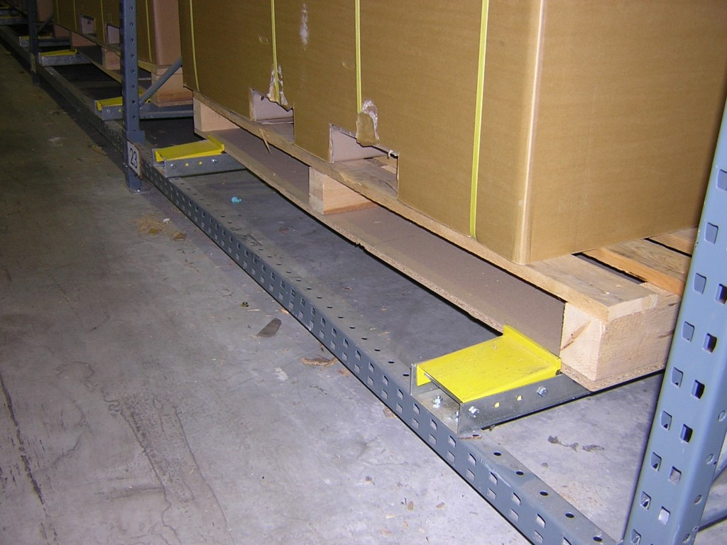 Pallet racking as push-back storage with end stop