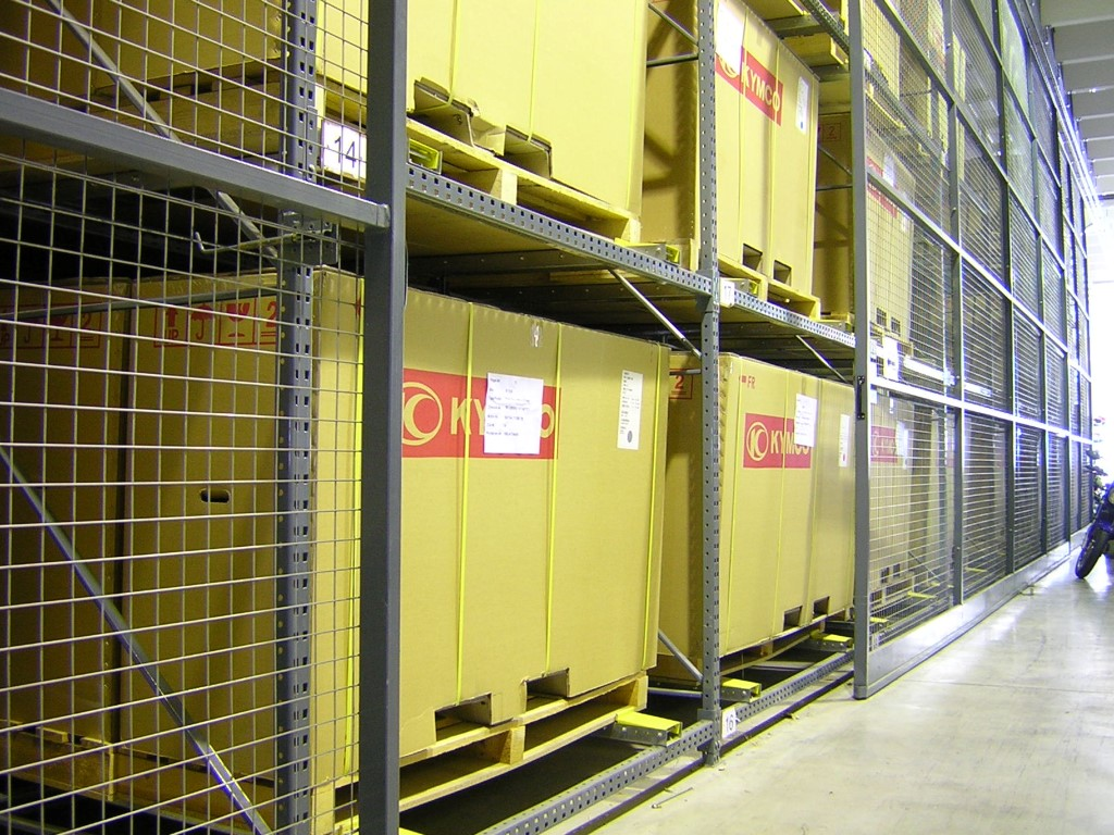 Pallet racking as push-back storage with sliding gate doors