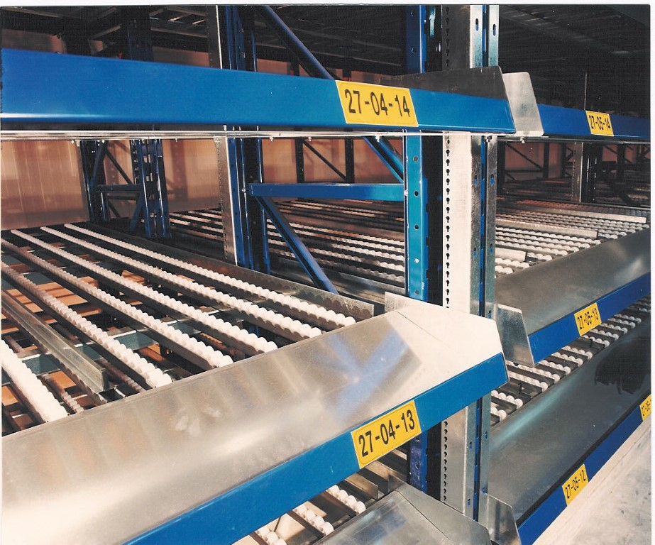 LIFO systems with detailed view of guide rails between wheel conveyors