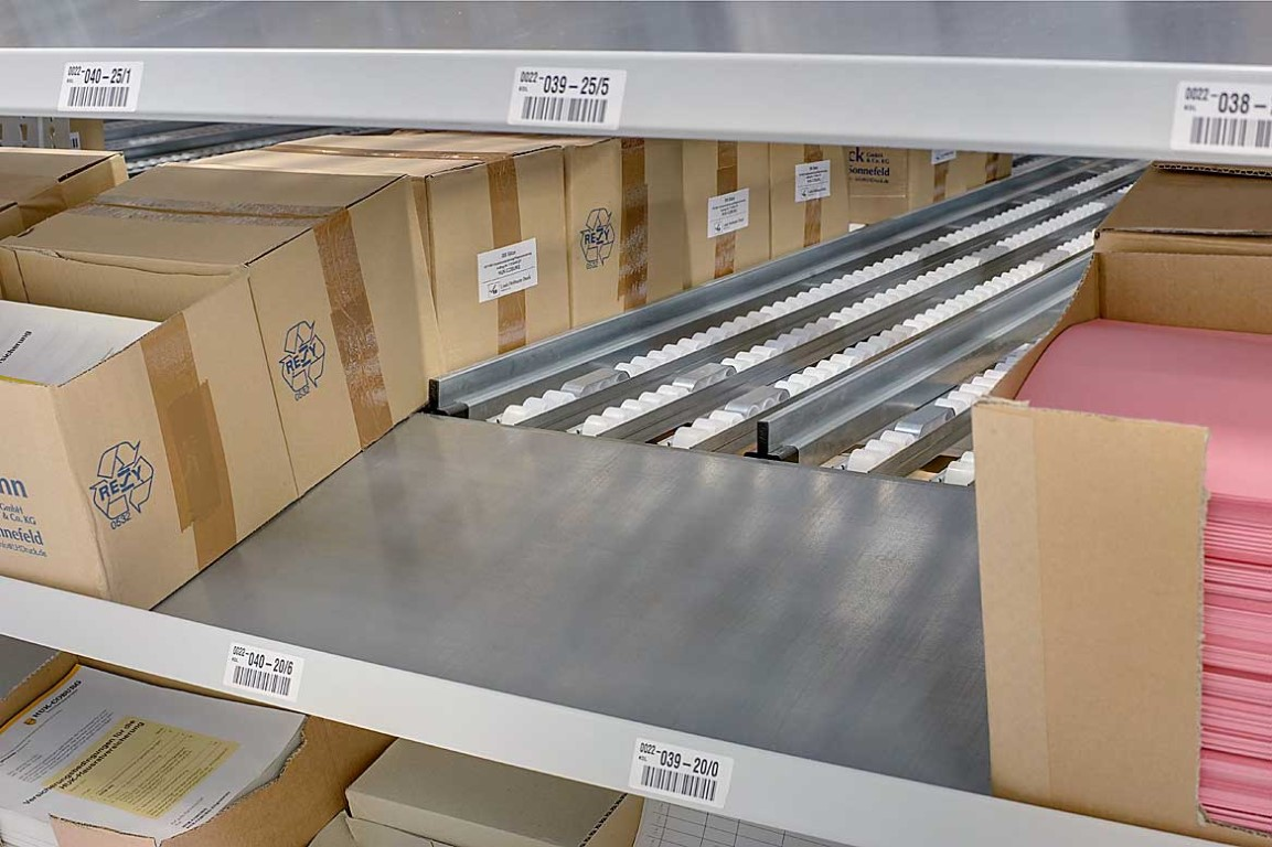 Order picking systems with tilted picking shelves
